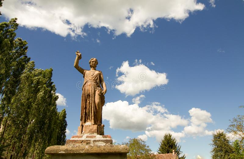 Sculpture of goddess protecting vineyards and grapes stock image