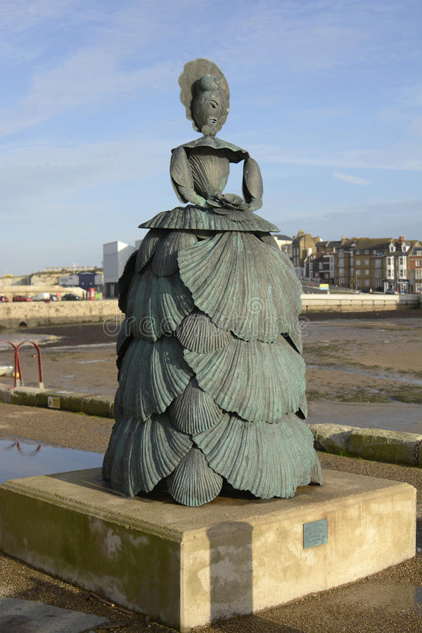 Sculpture on harbour side. Margate. Kent. England. Sculpture of Mrs Booth the Shell Lady by Ann Carrington 2009. On harbour side at Margate in Kent. England royalty free stock photography