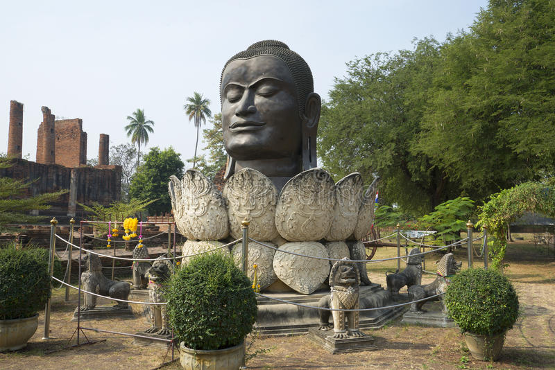 Sculpture head of the Buddha in the lotus flower. Wat in Authie, Thailand stock photos
