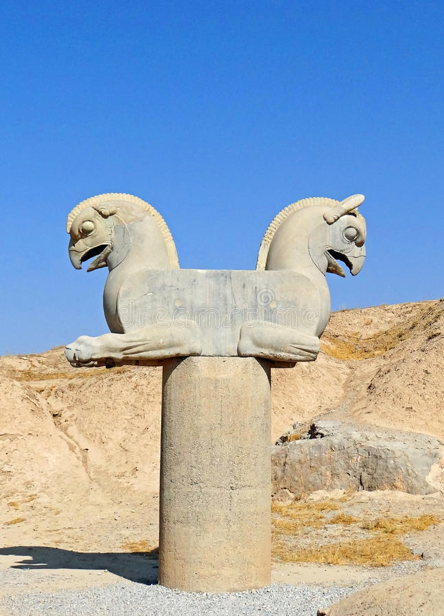 Sculpture of a Huma Bird in Persepolis, Iran. Statue of Two-Sided Lying Huma Birds on the Pole in the Ruins Complex of Persepolis in Iran royalty free stock photo