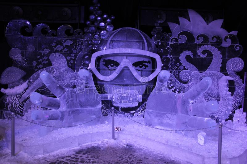 Ice installation.Underwater fantasy of frozen ice in the form of a diver in a mask stock photo