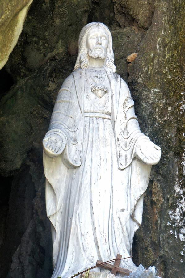 Sculpture Jesus Christ in a stone grotto . stock image