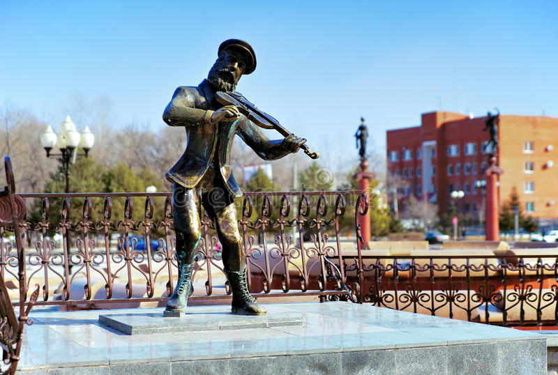 Sculpture of Jewish violinist in Birobidzhan stock photography