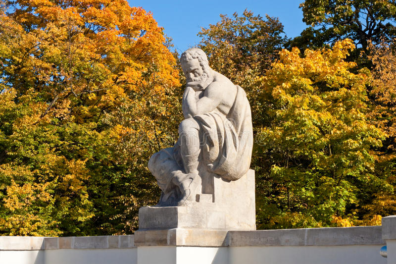 A sculpture in Lazienki park, Warsaw. One of the sculptures of authours in The Amphitheatre on the Island, Lazienki park, Warsaw stock photo