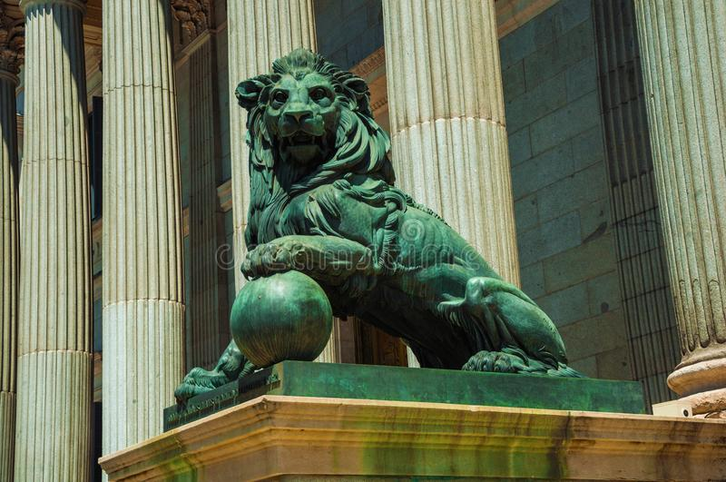 Sculpture lion cast in bronze on building facade in Madrid stock images