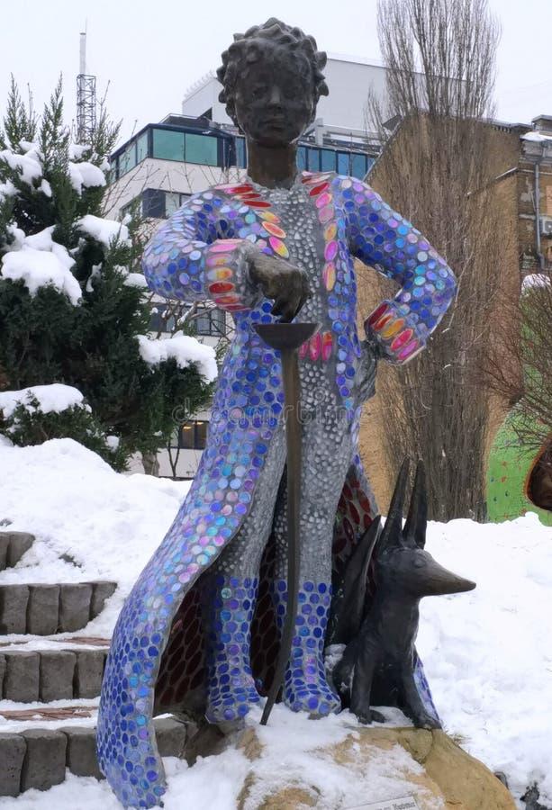 Sculpture of the Little Prince Antoine de Saint-Exupery and his fox. Children`s Park, Kiev royalty free stock photos