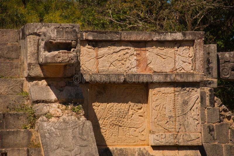 The sculpture of the Maya. Ancient Mayan city. Chichen-Itza, Mexico. Yucatan. The sculpture of the Maya. Ancient Mayan city. Ruined buildings and pyramids stock image
