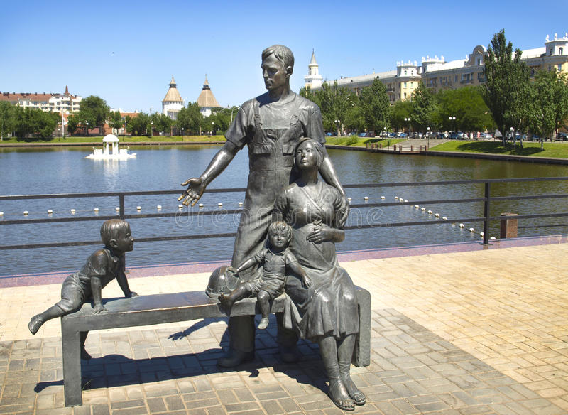 Sculpture of the miner`s family. Astrakhan. Russia. The city of Astrakhan.Russia. Sculpture near the swan lake stock photo
