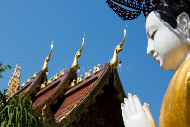 Sculpture of Monk in front of temple at Wat Phra Sing - Chiang Rai, Thailand stock photography