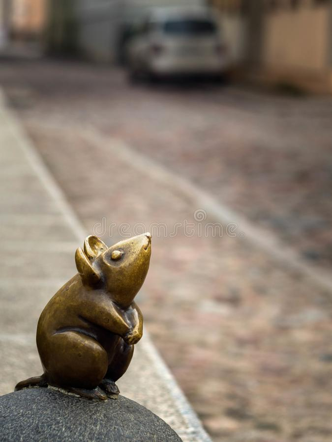 Sculpture of the Mouse with large ears sculptors S.Plotnikov and S.Yurkus performing desires on the cobbled street of the Old stock photo