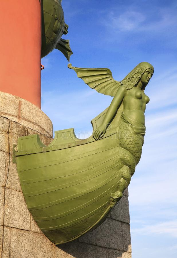 Sculpture Naiads on the nose of the ship. Rostral column. Saint Petersburg royalty free stock photo