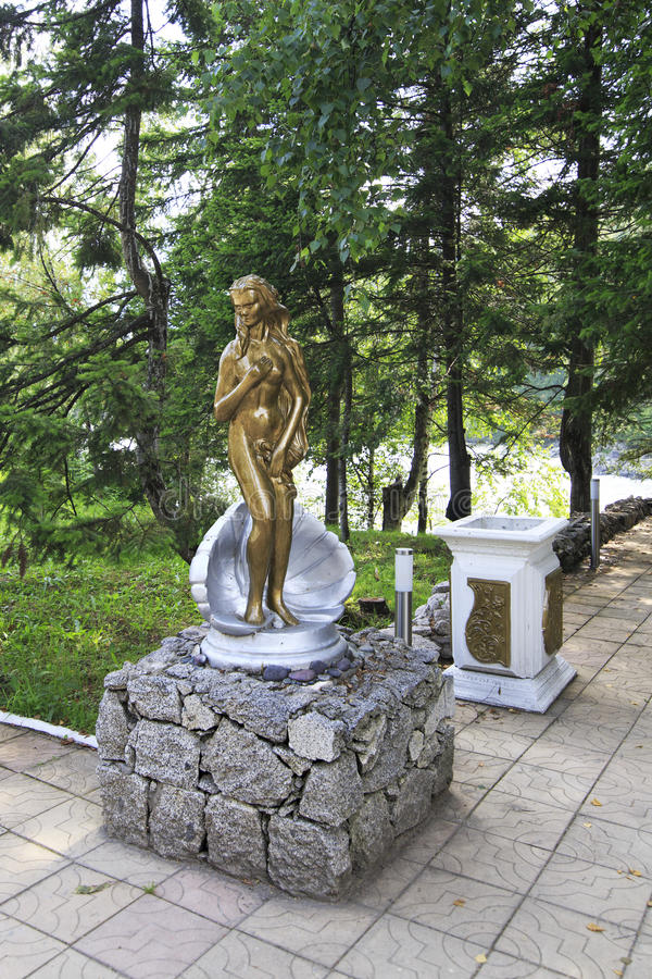 Sculpture of a naked girl in the pearl shell. Territory Altai Crown royalty free stock photos