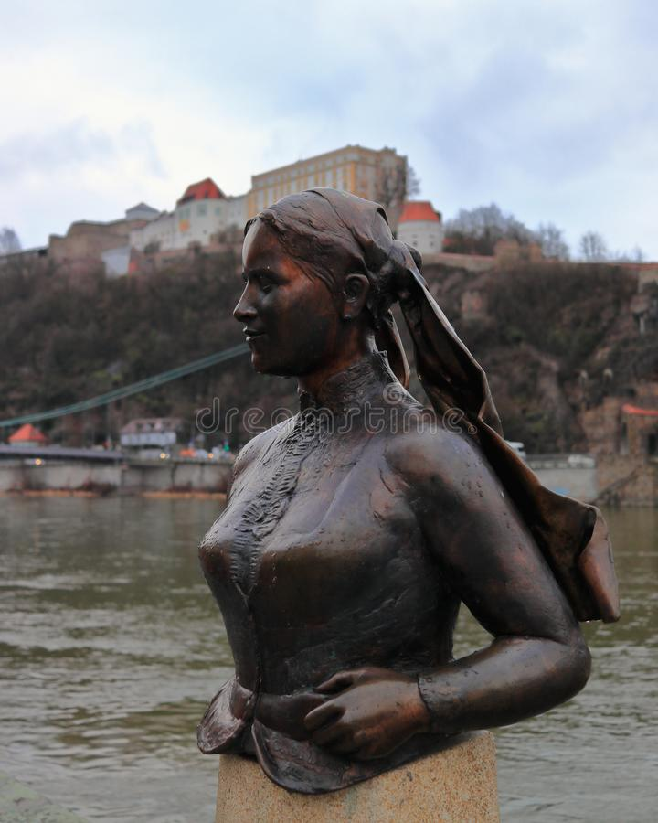 PASSAU, BAVARIA, GERMANY - MARCH 12, 2019: The bronze bust of Emerenz Meier, a Bavarian folk poetess. The sculpture near the Danube river was made by the artist royalty free stock images