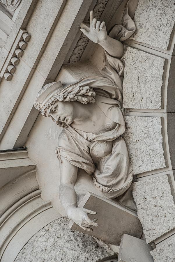 Free Sculpture Of Strange And Awkward People Of Renaissance Era As Support For Building Facade In Vienna Downtown, Austria, Details, Stock Photo - 156035160