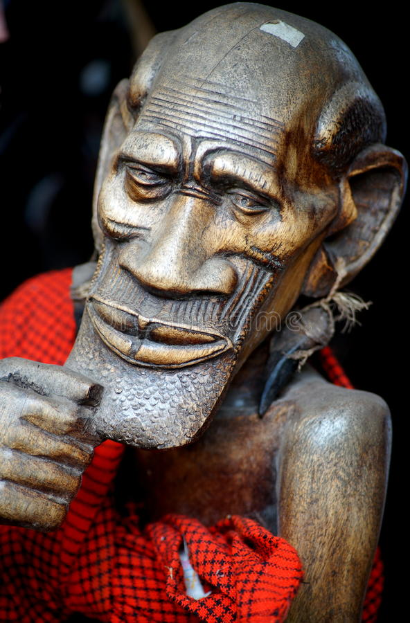 Sculpture of an old African man. Wooden sculpture of an old man on display in the cultural center of Arusha, Tanzania (East Africa royalty free stock photos
