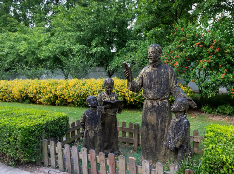 Sculpture of the old-style private teacher and students  in front of the Confucian Temple or Kongmiao. At Jiading, Shanghai, China stock photo