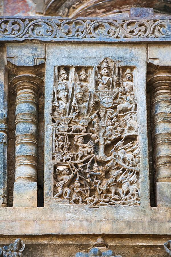 Sculpture of Pandavas picking up their weapons from the Shami tree. Chennakeshava temple. Belur, Karnataka. An episode from Mahabh. Sculpture of Pandavas picking stock photo