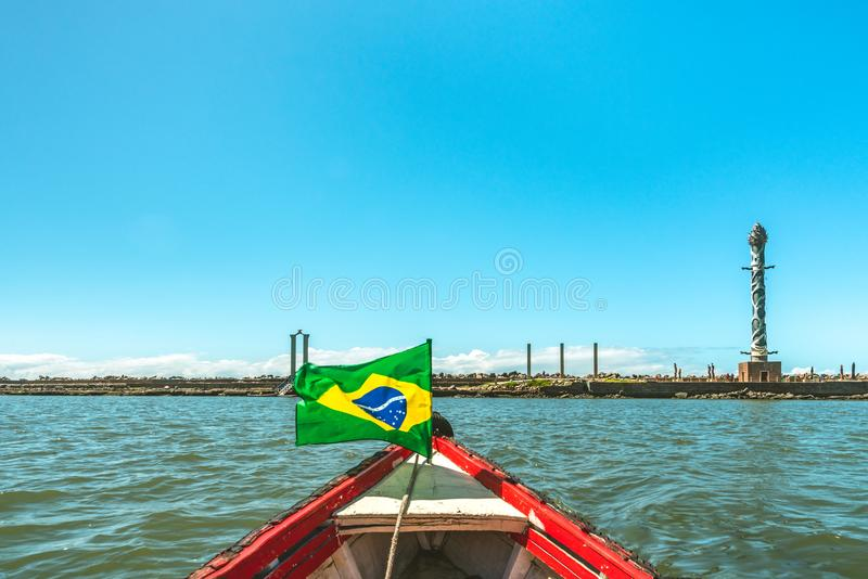 Sculpture Park Francisco Brennand, view from a boat in Capibaribe River with brazilian flag, Recife, Pernambuco stock photo