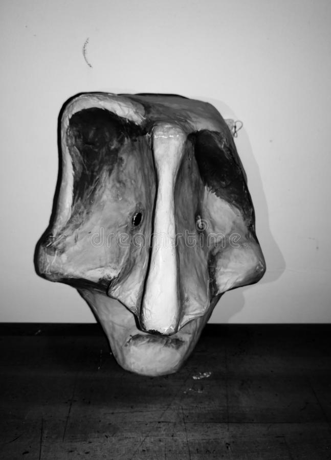 Sculpture of a person skull head with emotion of sadness and loneliness stock image