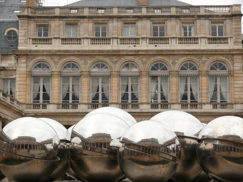Sculpture with polished steel spheres displayed in the courtyard of the Louvre museum in Paris royalty free stock photo