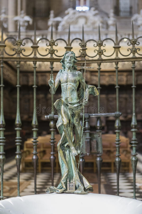Sculpture of risen Jesus made in bronze. Jaen - Spain, may 2016, 2: Sculpture of risen Jesus made in bronze, located at the entrance of the baptistery in the stock photos