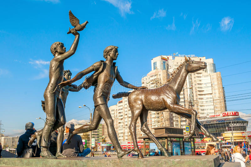 Sculpture Running children near the Pionerskaya metro station in St Petersburg, Russia. ST PETERSBURG, RUSSIA - OCTOBER 3, 2016. Sculpture Running children near stock images
