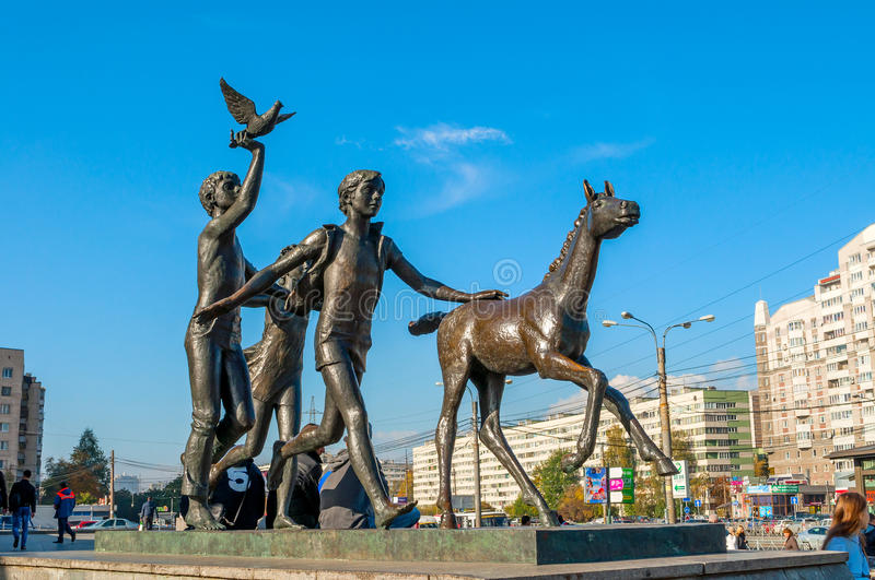 Sculpture Running children near the Pionerskaya metro station in St Petersburg, Russia - sculpture sunny view. ST PETERSBURG,RUSSIA-OCTOBER 3, 2016. Sculpture stock photography