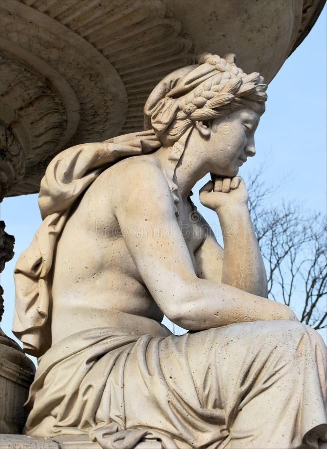 Sculpture of a sad girl royalty free stock photo