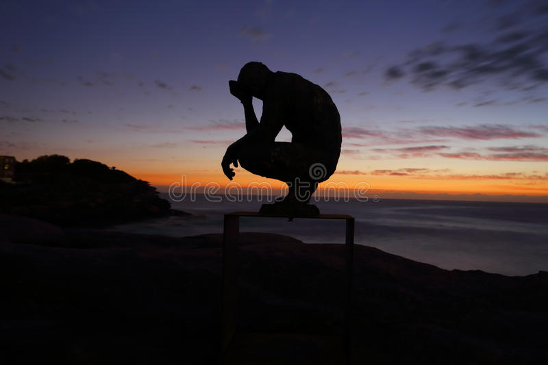 Sculpture by the Sea - Crouching Man. BONDI, AUSTRALIA - OCTOBER 25, 2015; Annual Sculpture by the Sea free public event. Exhibit titled Crouching Man by stock photos