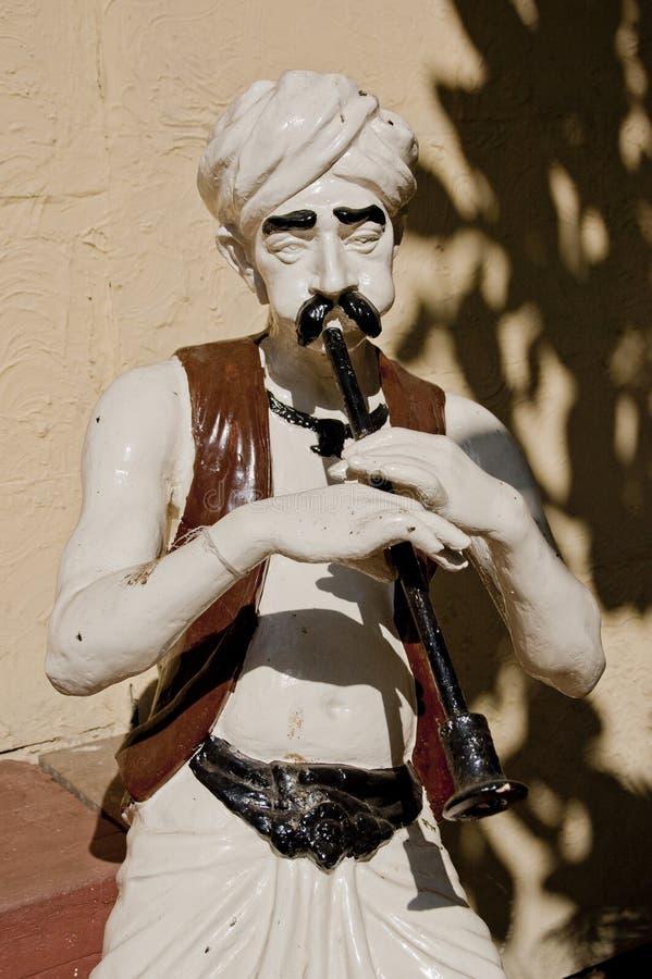 Sculpture of a snake charmer. Outdoor sculpture of a snake charmer in Mumbai royalty free stock photo