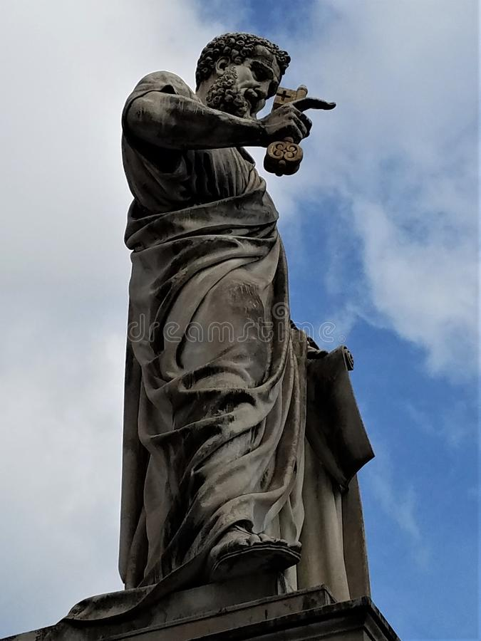Sculpture of St. Peter in St. Peter`s Square. St. Peter with the keys to the kingdom rises impressively above St. Peter`s Square in Rome. Sculpture was finished stock images