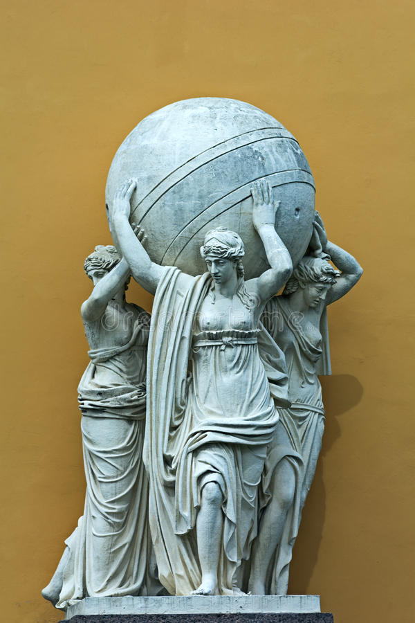Sculpture. ST. PETERSBURG, RUSSIA - JULY 12, 2016: Sculpture `The statues of nymphs carrying the celestial sphere`, building of the Admiralty, St. Petersburg royalty free stock images