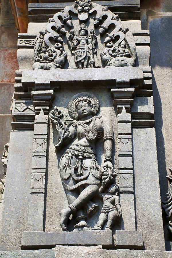 Sculpture of a Sundari, Beatiful Lady, going out with her child. Chennakesava temple, Belur, Karnataka. Sculpture of a Sundari, Beatiful Lady, going out with stock image