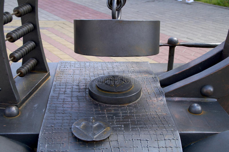 Sculpture to the machine tool for stamping of coins stock photos