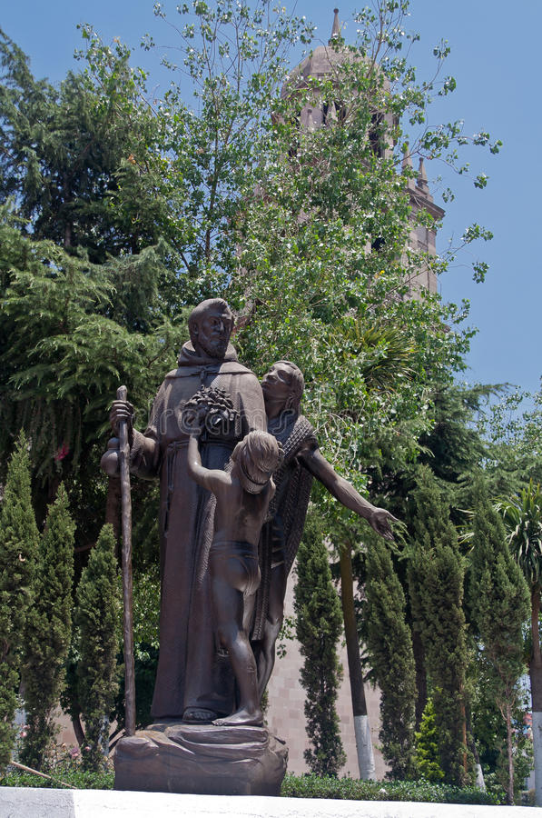 Sculpture in Toluca de Lerdo Mexico. A sculpture of San Francisco in front of the tower of the cathedral of Toluca de Lerdo, Mexico royalty free stock image