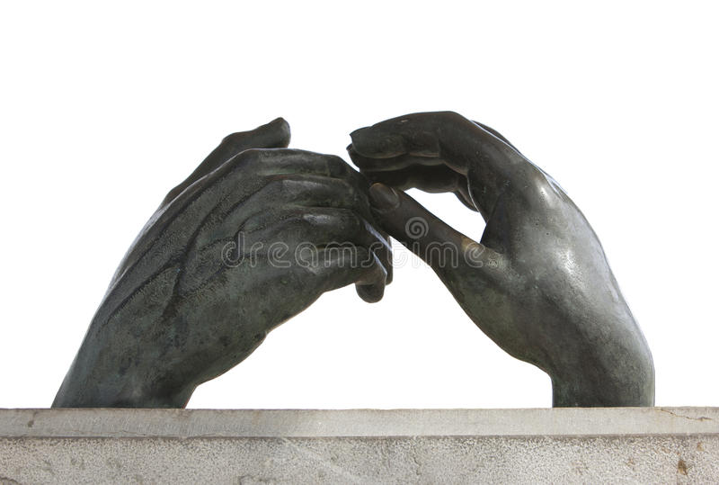 Sculpture of two hands touching stock image