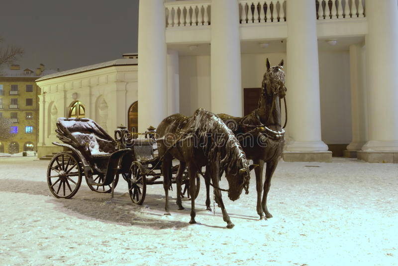 Sculpture of two horses with crew stock photos