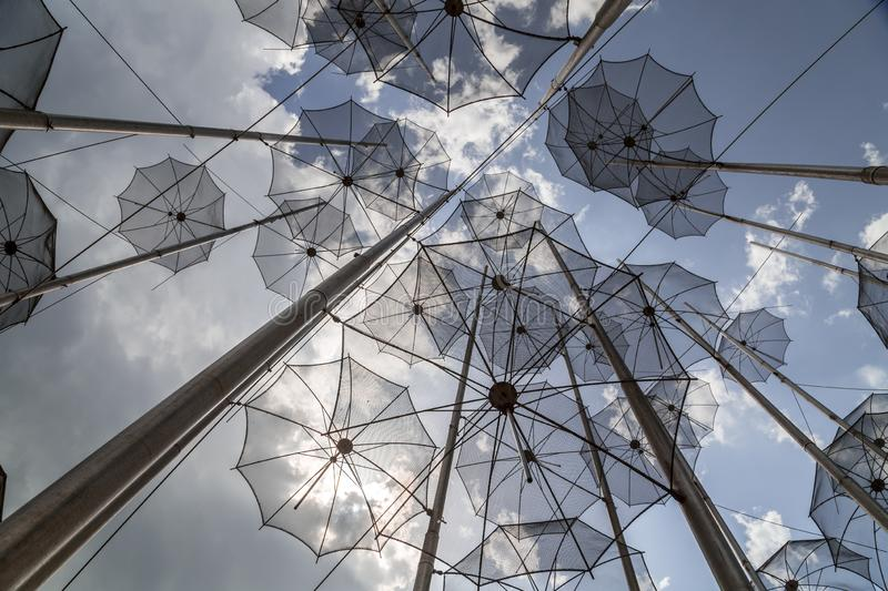 The sculpture Umbrellas located at the New Beach in Thessaloniki, Greece. The sculpture Umbrellas by George Zongolopoulos located at the New Beach in stock images