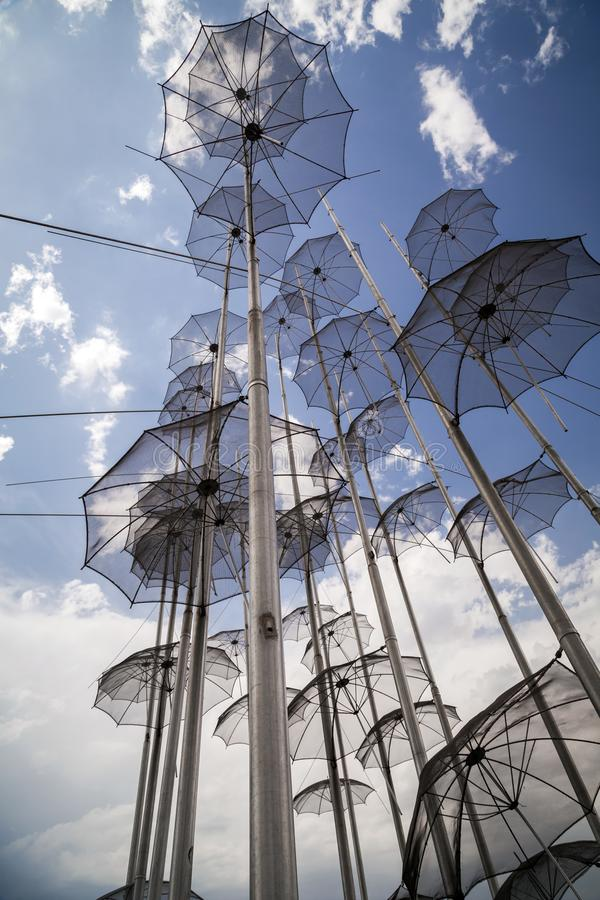 The sculpture Umbrellas located at the New Beach in Thessaloniki, Greece. The sculpture Umbrellas by George Zongolopoulos located at the New Beach in royalty free stock photo