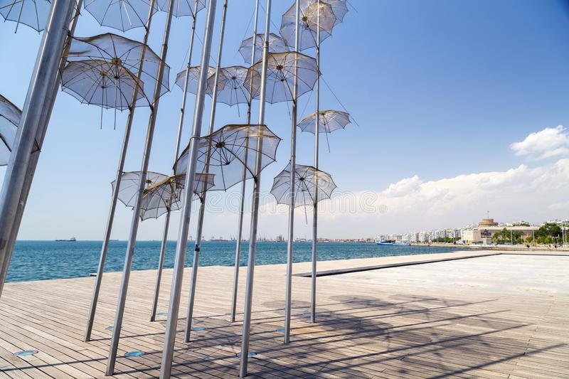 The sculpture Umbrellas by George Zongolopoulos located at the New Beach in Thessaloniki, Greece. Thessaloniki, Greece - July 23, 2018: The sculpture Umbrellas royalty free stock images