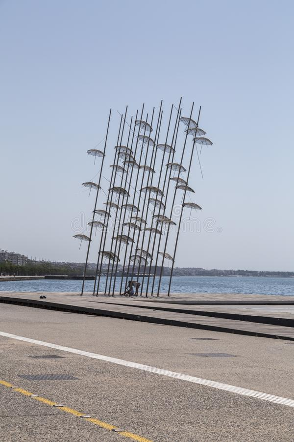 The sculpture Umbrellas by George Zongolopoulos located at the New Beach in Thessaloniki, Greece. Thessaloniki, Greece - July 23, 2018: The sculpture Umbrellas royalty free stock image