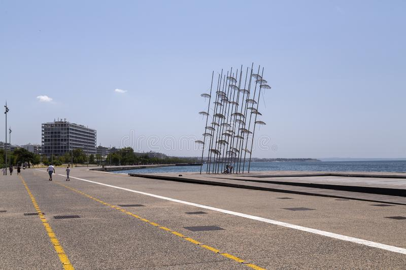 The sculpture Umbrellas by George Zongolopoulos located at the New Beach in Thessaloniki, Greece. Thessaloniki, Greece - July 23, 2018: The sculpture Umbrellas stock photography