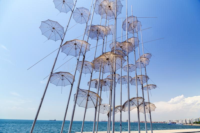 The sculpture Umbrellas by George Zongolopoulos located at the New Beach in Thessaloniki, Greece. Thessaloniki, Greece - July 23, 2018: The sculpture Umbrellas royalty free stock photography