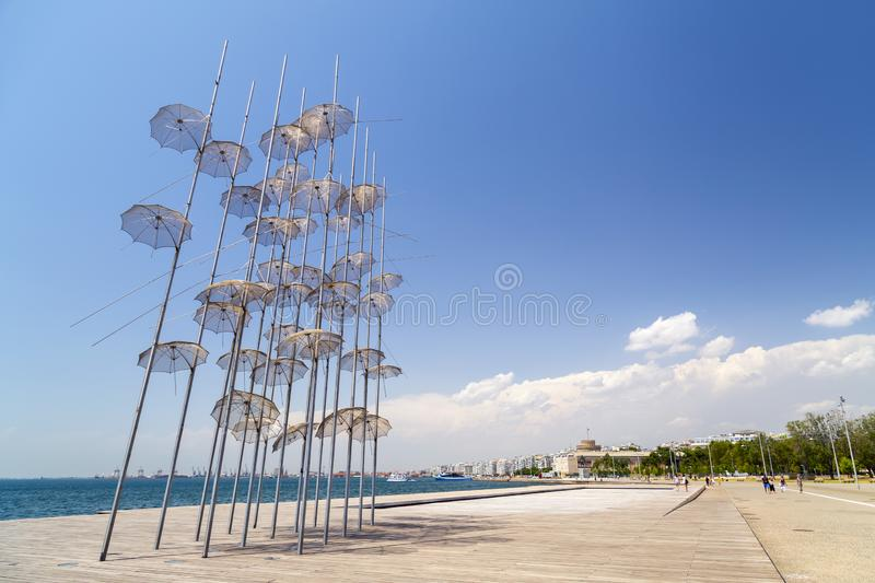The sculpture Umbrellas by George Zongolopoulos located at the New Beach in Thessaloniki, Greece. Thessaloniki, Greece - July 23, 2018: The sculpture Umbrellas stock images