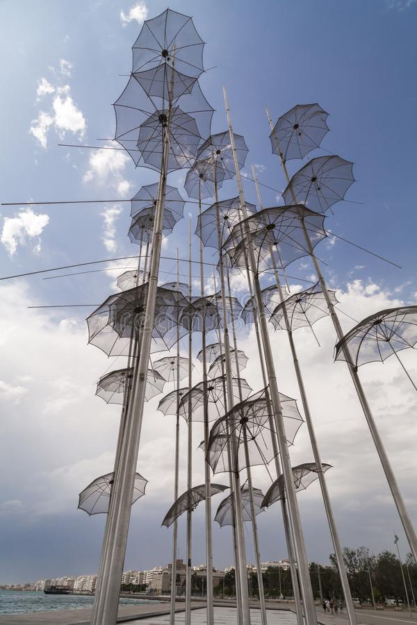 The sculpture Umbrellas by George Zongolopoulos located at the New Beach in Thessaloniki, Greece. Thessaloniki, Greece - July 23, 2018: The sculpture Umbrellas stock photo