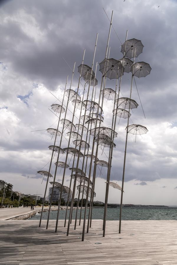 The sculpture Umbrellas by George Zongolopoulos located at the New Beach in Thessaloniki, Greece. Thessaloniki, Greece - July 23, 2018: The sculpture Umbrellas stock image