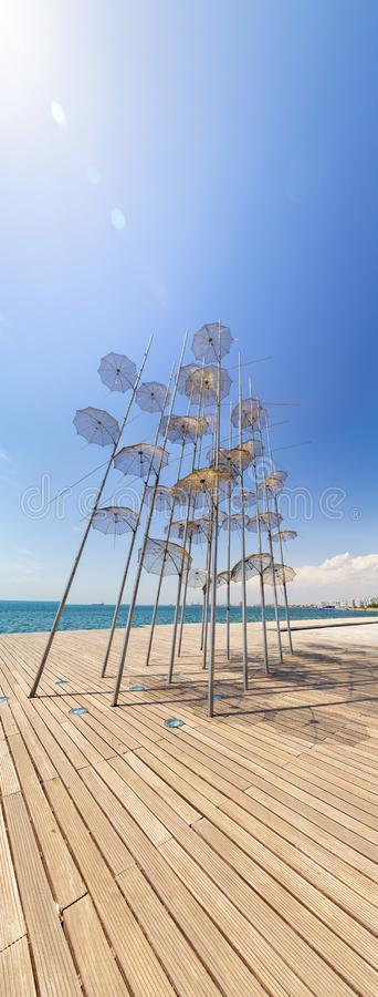 The sculpture Umbrellas by George Zongolopoulos located at the New Beach in Thessaloniki, Greece. Thessaloniki, Greece - July 23, 2018: The sculpture Umbrellas royalty free stock photo