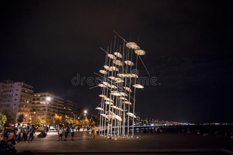 The sculpture Umbrellas by George Zongolopoulos located at the New Beach in Thessaloniki, Greece. Thessaloniki, Greece - July 25, 2018: The sculpture Umbrellas royalty free stock photo