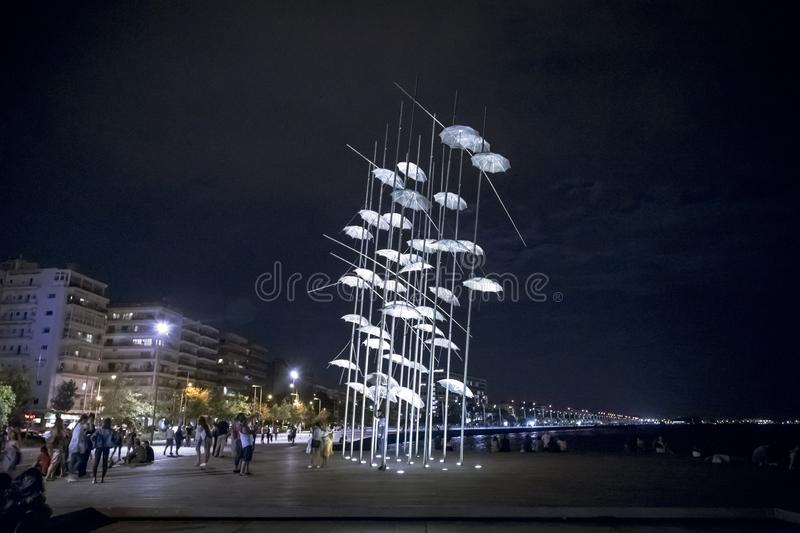 The sculpture Umbrellas by George Zongolopoulos located at the New Beach in Thessaloniki, Greece. Thessaloniki, Greece - July 25, 2018: The sculpture Umbrellas royalty free stock photos