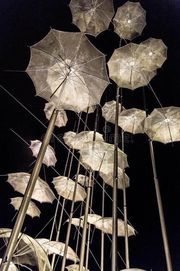 The sculpture Umbrellas by George Zongolopoulos located at the New Beach in Thessaloniki, Greece. Thessaloniki, Greece - July 25, 2018: The sculpture Umbrellas stock photography